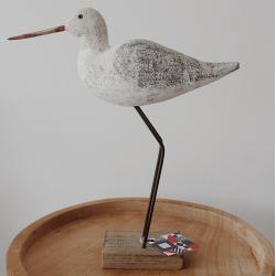 Vogel aus Holz mit grauem Gefieder